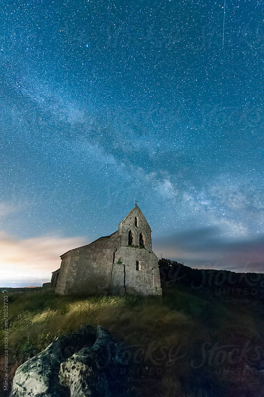 Milky way over a small church by Marilar Irastorza for Stocksy United