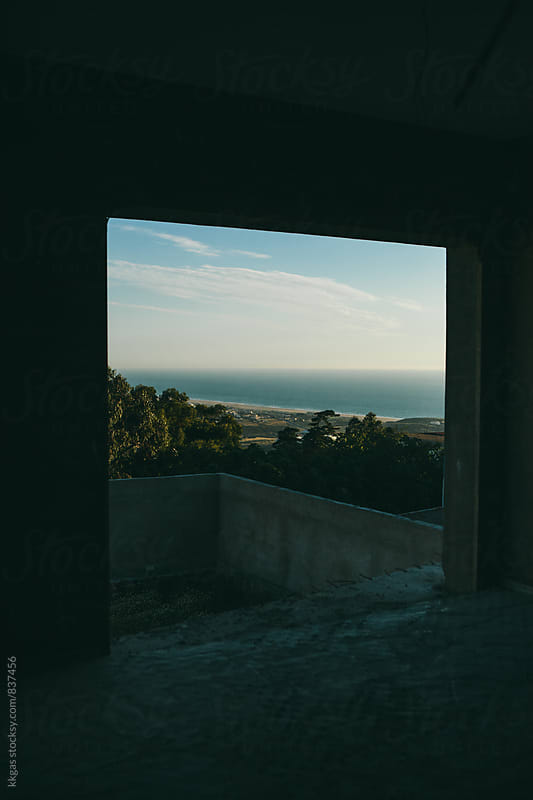 View through an unfinished building of a beach by kkgas for Stocksy United