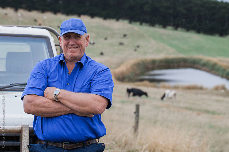 Dairy Farmer on his Dairy Farm by Rowena Naylor for Stocksy United