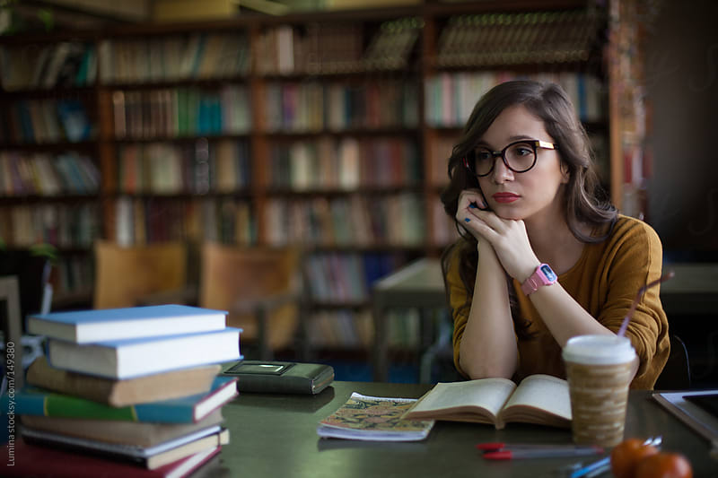 Young Woman at the Library by Lumina for Stocksy United