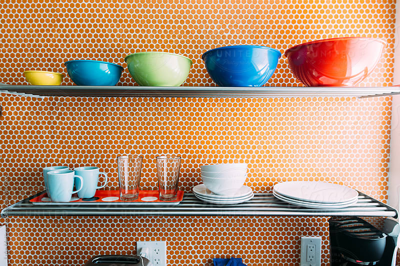 Cups, Bowls and Plates Organized On Kitchen Shelf by Luke Mattson for Stocksy United