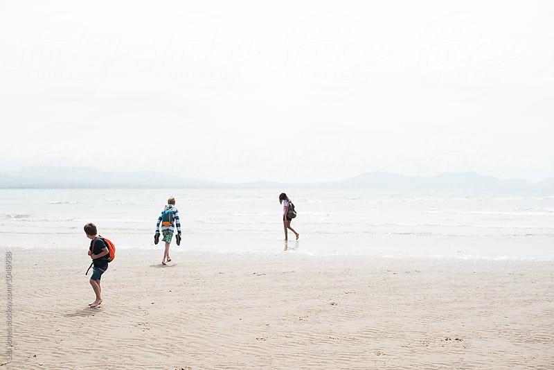 kids walking on the beach by Léa Jones for Stocksy United