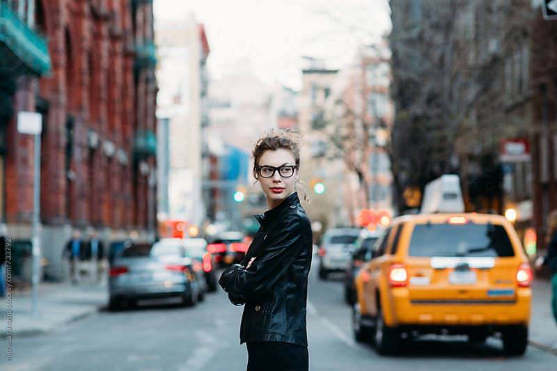 Young professional woman on the streets of New York City by michela ravasio for Stocksy United