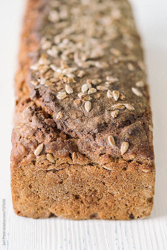 home backed bread with cereals by Juri Pozzi for Stocksy United