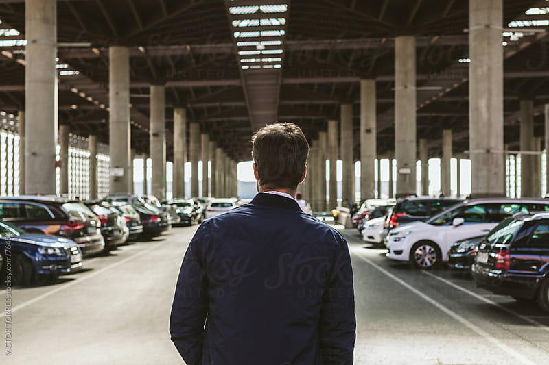 Elegant Young Businessman in an Outdoor Car Parking by VICTOR TORRES for Stocksy United