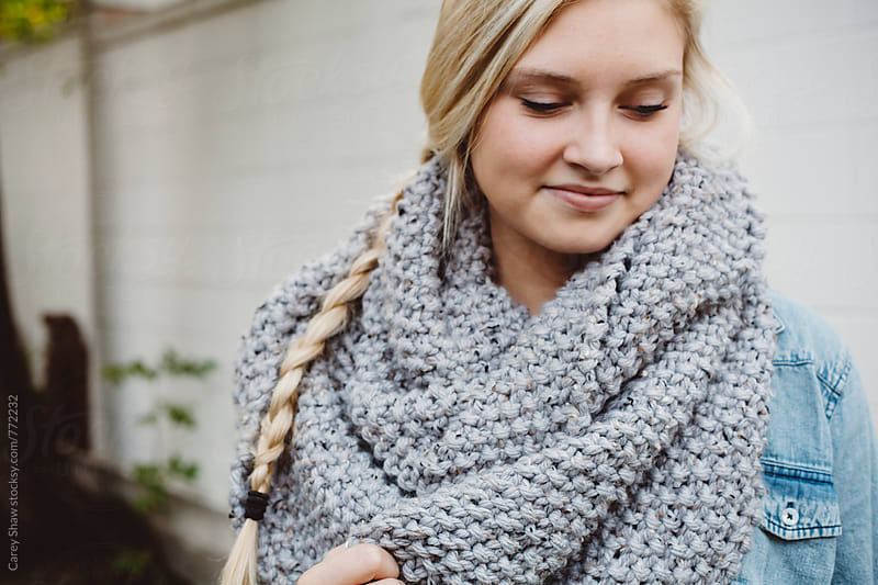 Pretty young woman wearing grey knit scarf by Carey Shaw for Stocksy United