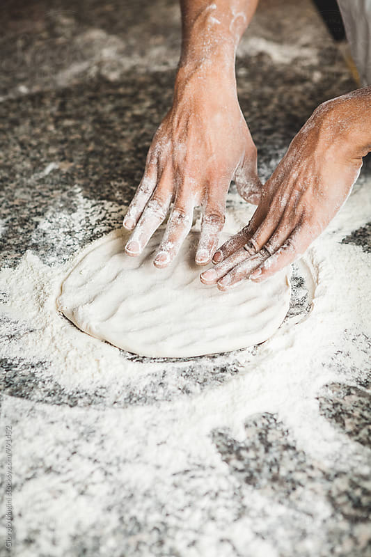 Kneading and Shaping the Pizza Dough by Giorgio Magini for Stocksy United
