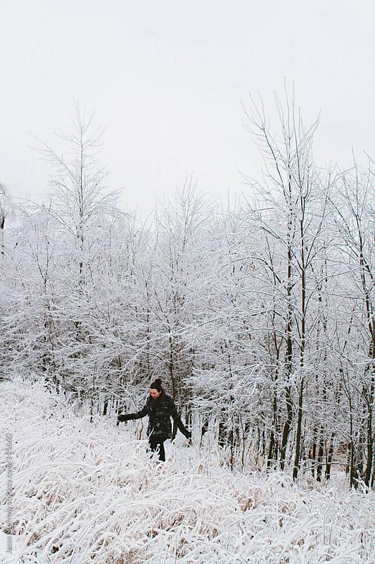 Walking in a winter wonderland  by Jesse Morrow for Stocksy United
