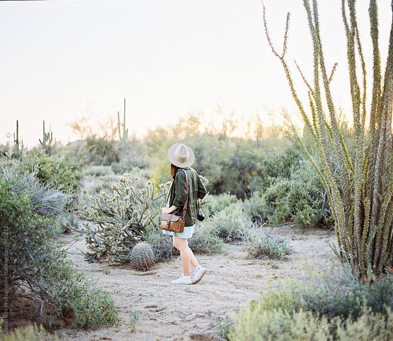 Woman walking in desert by Daniel Kim Photography for Stocksy United