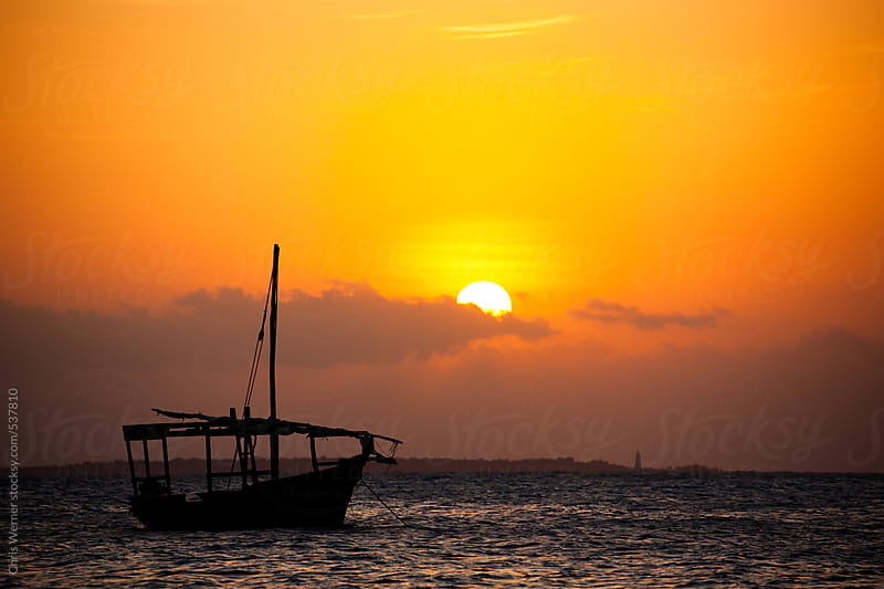 Dhow at sunset by Chris Werner for Stocksy United