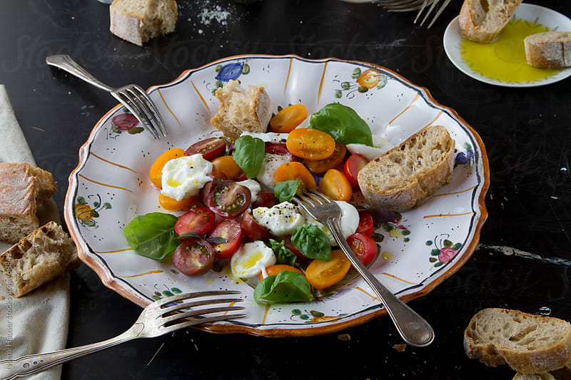 Tomato-mozzarella salad  by Noemi Hauser for Stocksy United