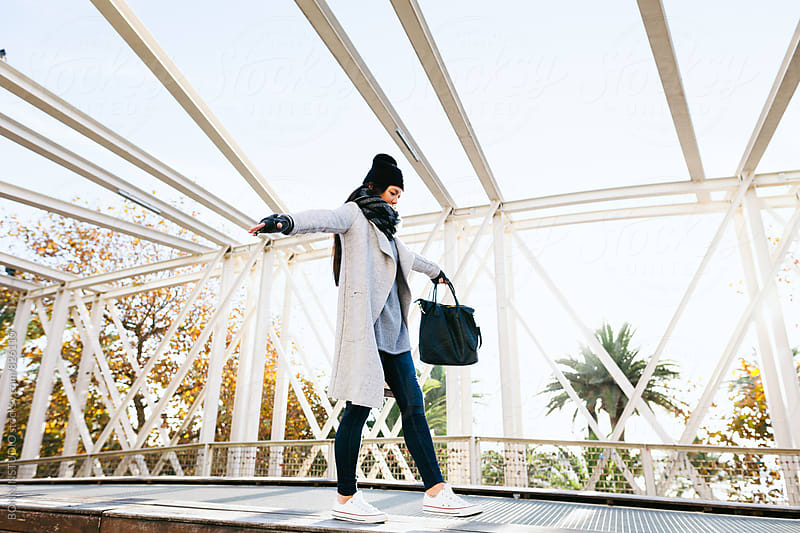 Asian woman enjoying a sunny winter day in the city. by BONNINSTUDIO for Stocksy United