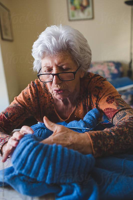 Elderly woman knitting by michela ravasio for Stocksy United