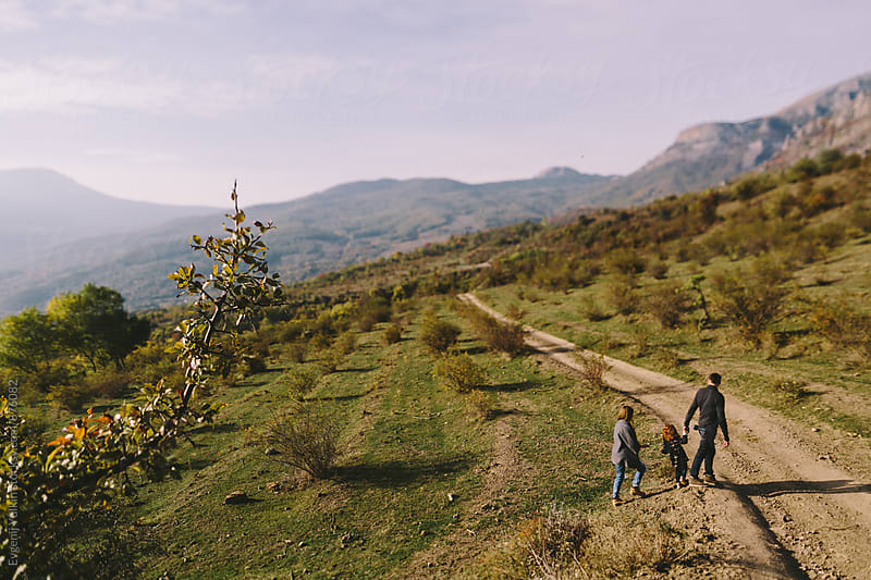 Family walk on the hillside by Evgenij Yulkin for Stocksy United