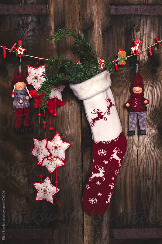 Hanging Christmas stockings  by Pixel Stories for Stocksy United