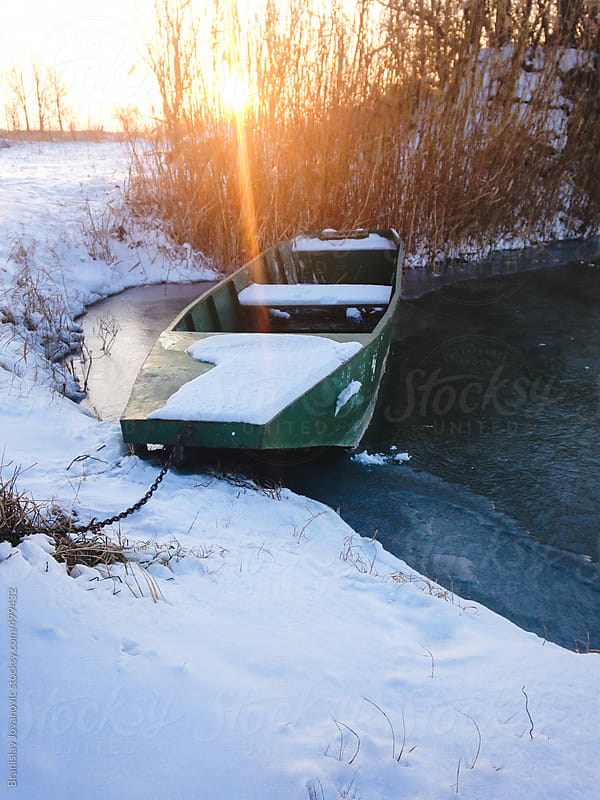 Boat on the lake at winter time by Brkati Krokodil for Stocksy United