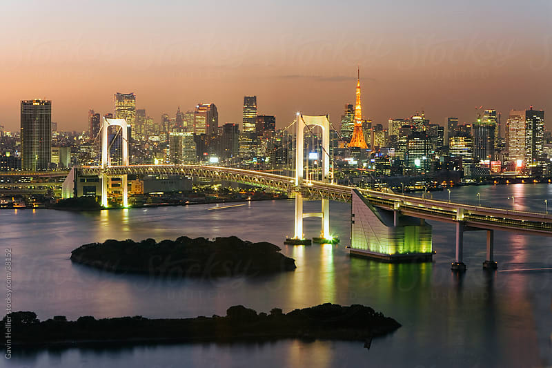 Asia, Japan, Tokyo, Tokyo Bay, Odaiba, Rainbow Bridge and Tokyo Tower illuminated at dusk - elevated by Gavin Hellier for Stocksy United