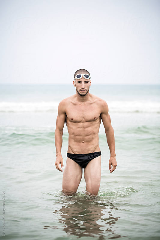 Portrait of swimmer in the sea by Lior + Lone for Stocksy United