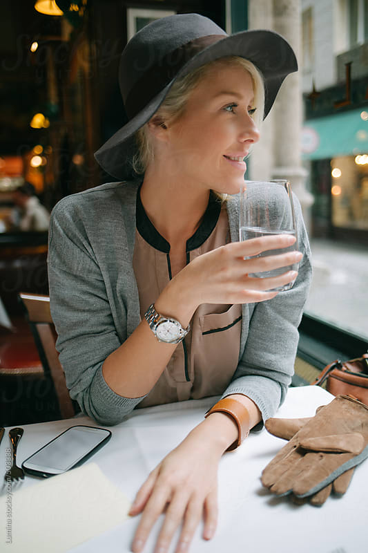 Happy Woman at a Restaurant by Lumina for Stocksy United