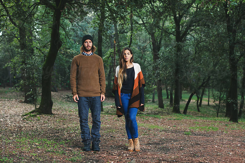Portrait of a couple standing in the middle of the forest. by BONNINSTUDIO for Stocksy United