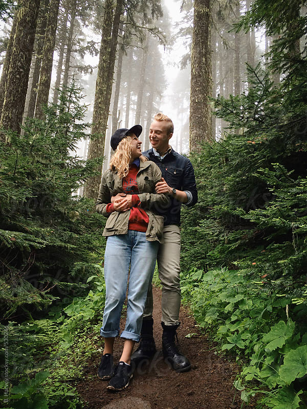 Young Blonde Couple Hiking by B. Harvey for Stocksy United