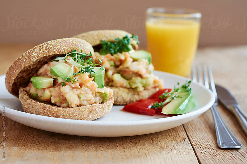 English muffins loaded with a creamy bean and vegetable pate. by Harald Walker for Stocksy United