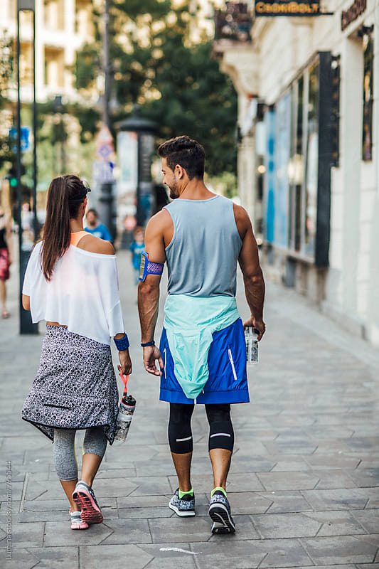 Couple in Sportswear Walking on the Street by Lumina for Stocksy United