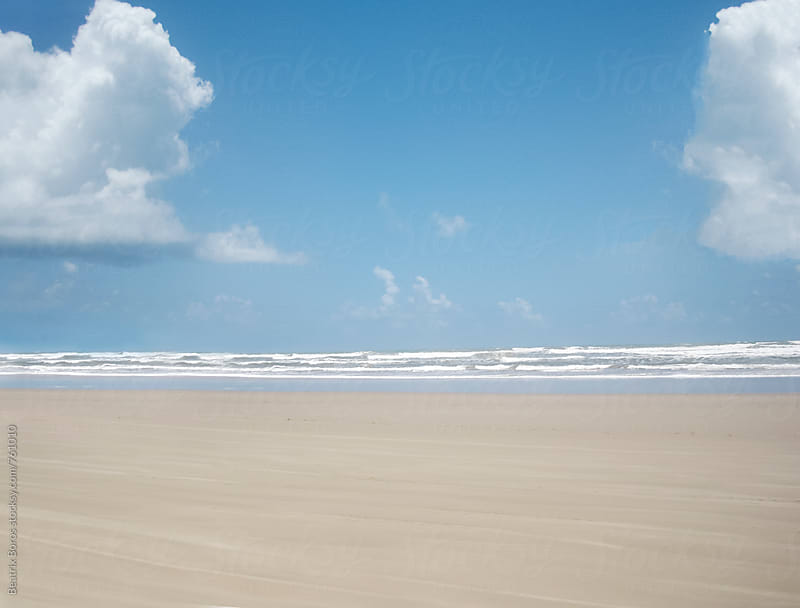 Minimal photo of the sand sky, and the ocean in the distance by Beatrix Boros for Stocksy United