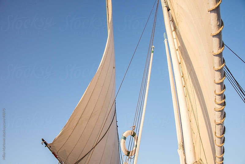Sails of a boat on the river Nile in Egypt. by Mike Marlowe for Stocksy United