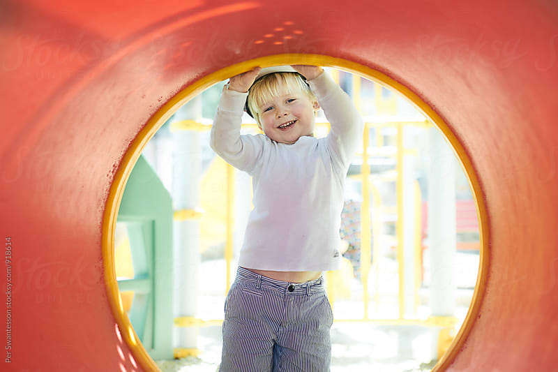 Young happy boy on a playground by Per Swantesson for Stocksy United