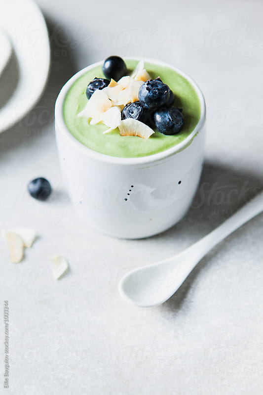Matcha yogurt cup by Ellie Baygulov for Stocksy United
