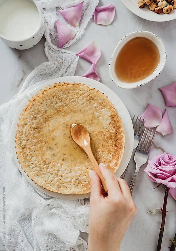 Crepes with honey and hazelnuts by Tatjana Ristanic for Stocksy United
