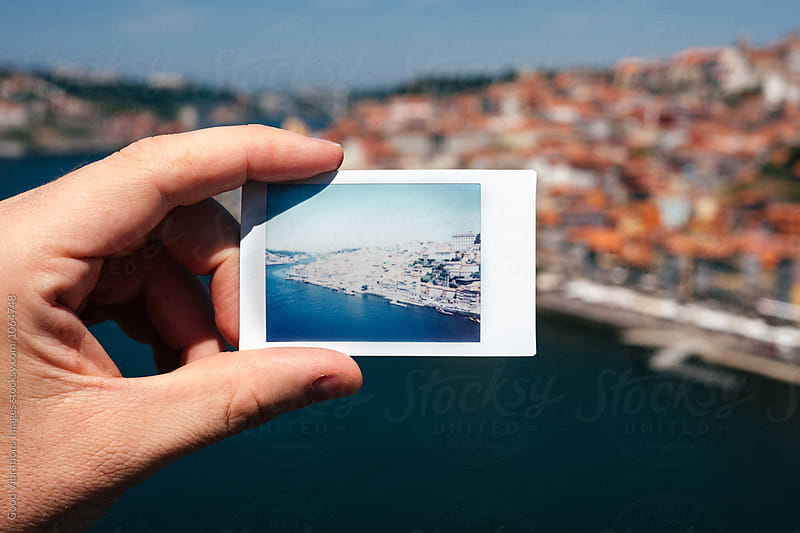 Man holding a polaroid of Oporto, Portugal by Good Vibrations Images for Stocksy United