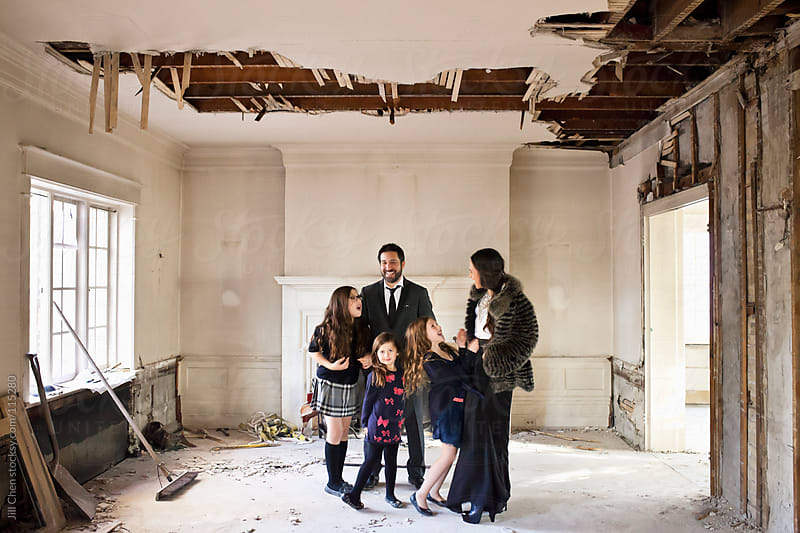 Family Buying New Home by Jill Chen for Stocksy United