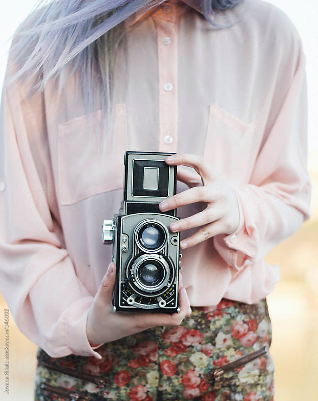 Young woman with a retro camera by Jovana Rikalo for Stocksy United