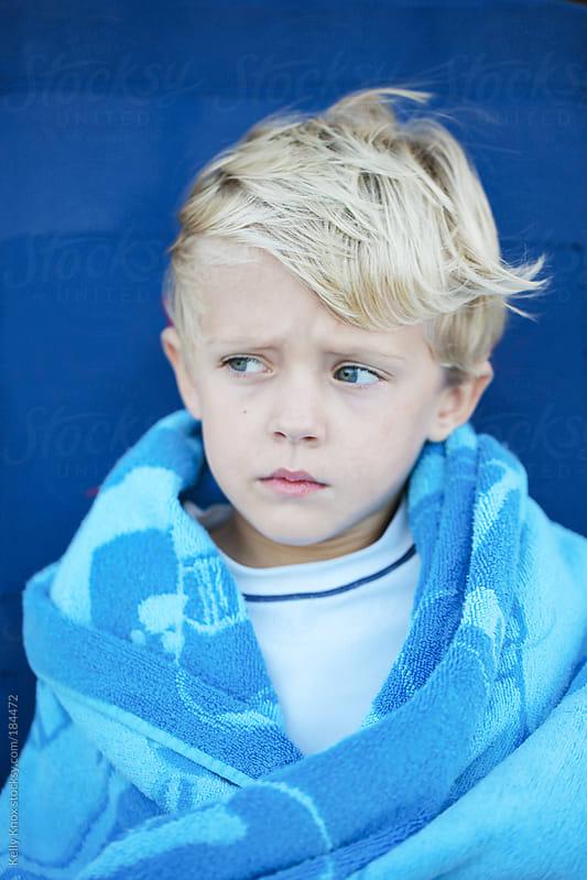 boy sitting in a beach chair by Kelly Knox for Stocksy United