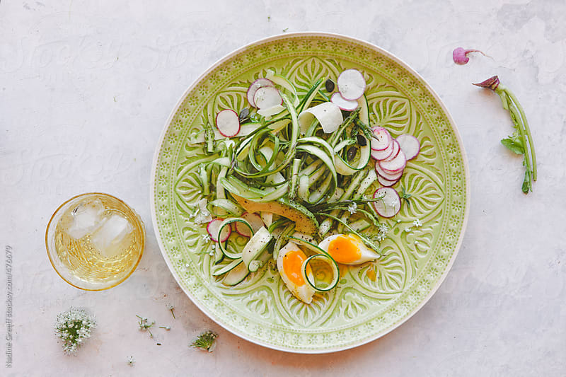 Shaved asparagus, zucchini, radish, egg and avocado salad by Nadine Greeff for Stocksy United