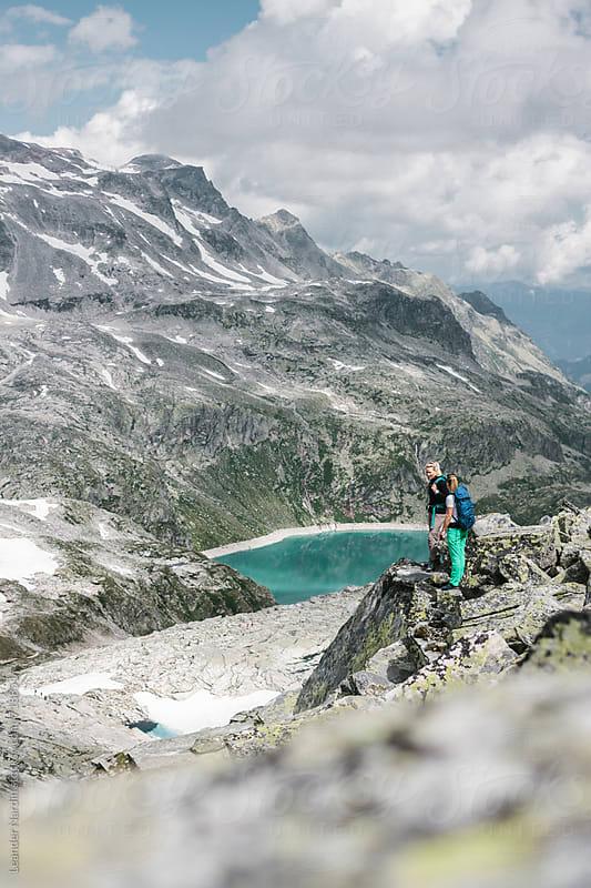 two female hiker in high alpine glacier scenery by Leander Nardin for Stocksy United