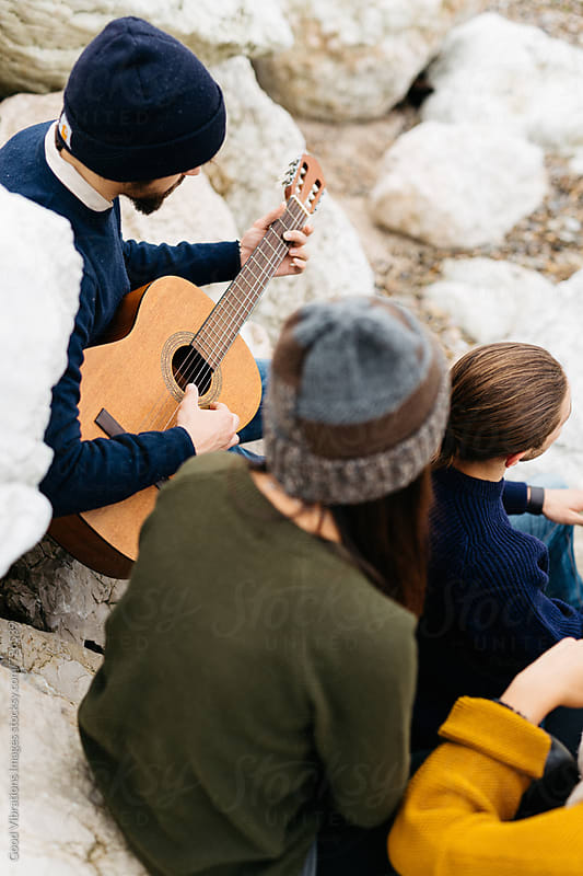 Group of friends with a guitar by Good Vibrations Images for Stocksy United