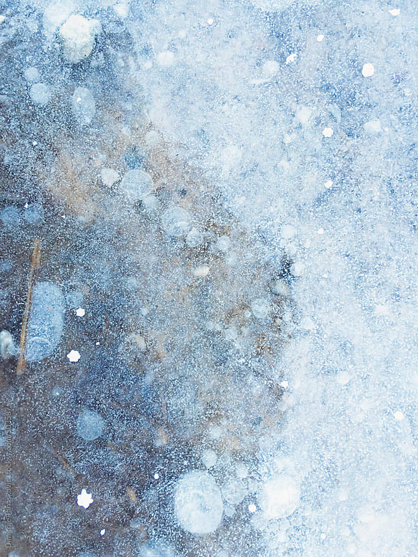 Frozen water surface background by Dimitrije Tanaskovic for Stocksy United