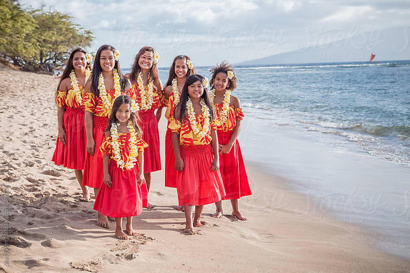 Group of Traditional Hawaiian Hula Dancers Standing on the Beach by Shelly Perry for Stocksy United
