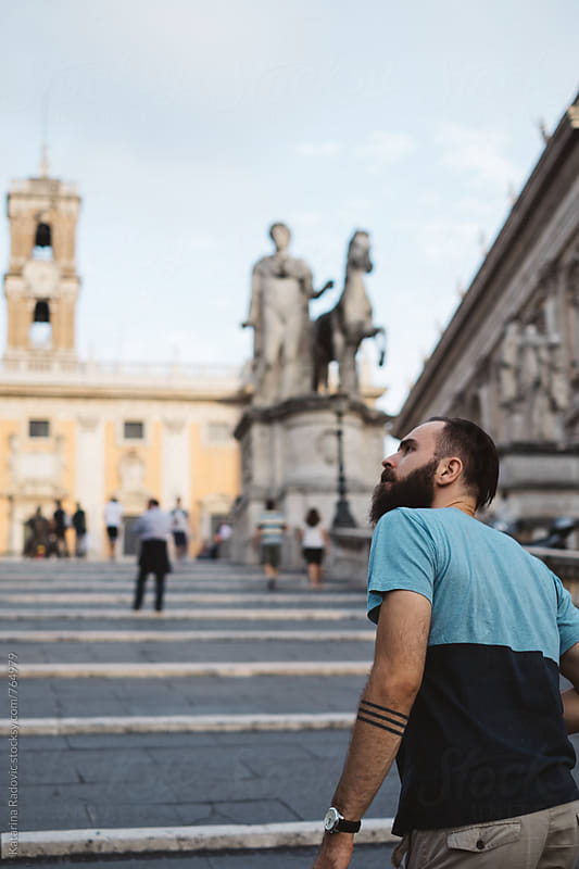 Bearded Man Walking and Sightseeing the Rome by Katarina Radovic for Stocksy United