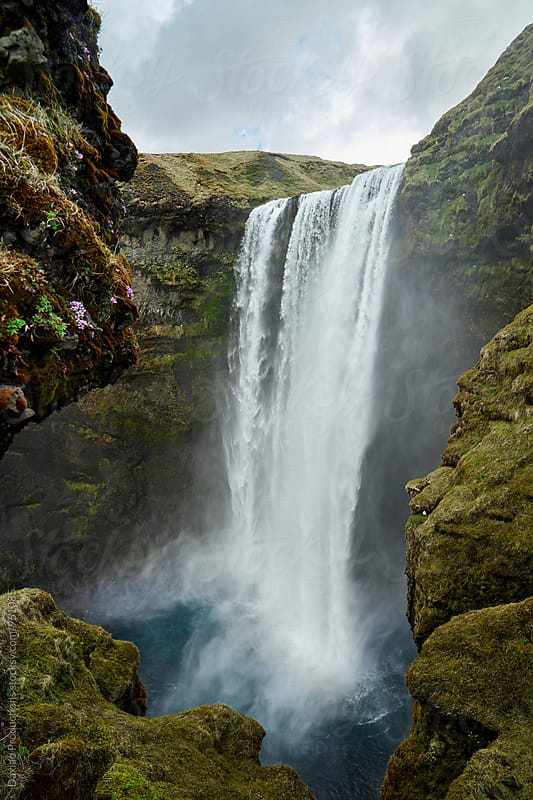 Skogafoss waterfall in iceland , famous tourist attraction by Daxiao Productions for Stocksy United