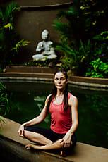 woman doing advanced pigeon yoga pose  stocksy united