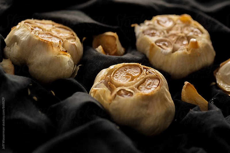 Roast Garlic in Dark Setting by Jeff Wasserman for Stocksy United