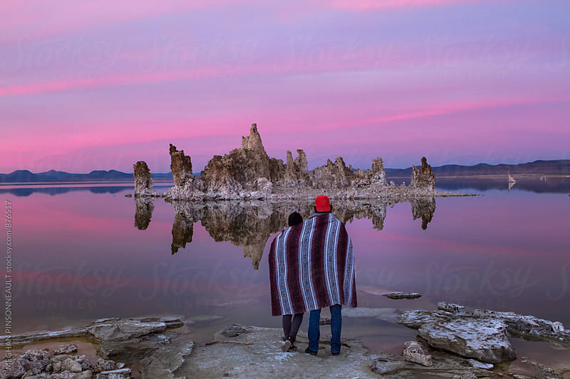 Couple Watching Vibrant Sunset on Lake with Tufas by MEGHAN PINSONNEAULT for Stocksy United