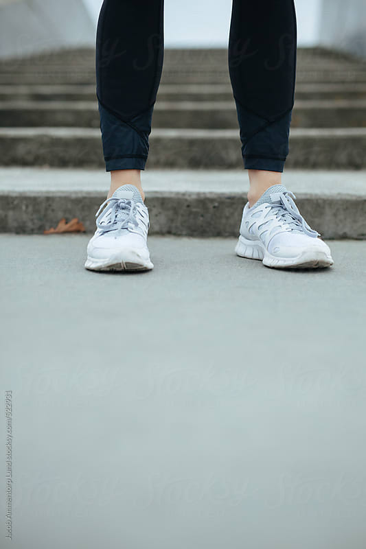 Female athlete feet on steps by Jacob Ammentorp Lund for Stocksy United