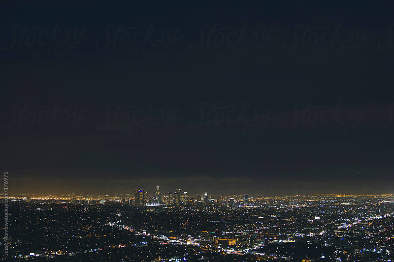 City lights at night  by Jesse Morrow for Stocksy United