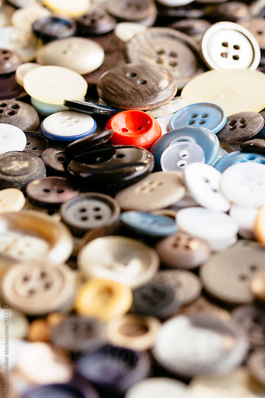 Closeup of old buttons by Harald Walker for Stocksy United