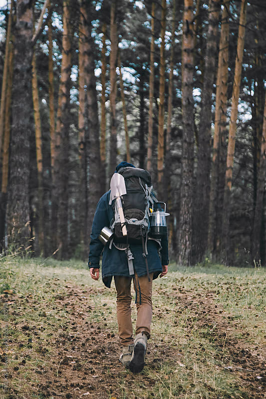 Traveler walking through the forest by Danil Nevsky for Stocksy United